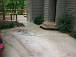 RB Engineering inspected the structure, noting that the concrete driveway contained severe cracks as a result of slab settlement and sloped toward the front corner of the left foundation wall.  The exterior foundation wall contained several exterior foundation cracks.