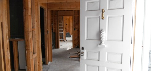 Holzworth Remodel showing the antique front door and exposed timber framing on the first floor